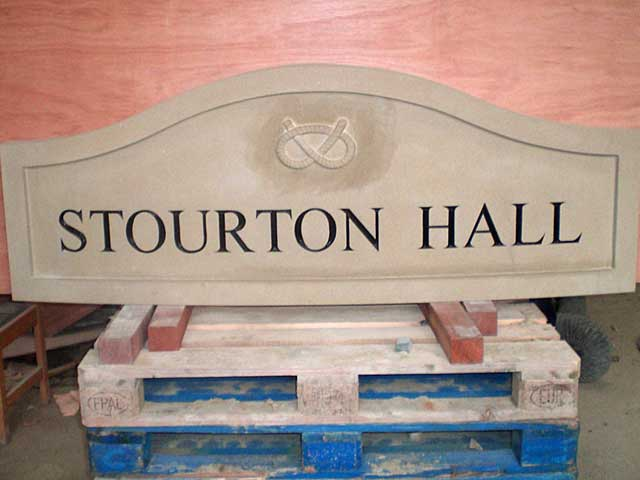 Carved yorkstone house sign