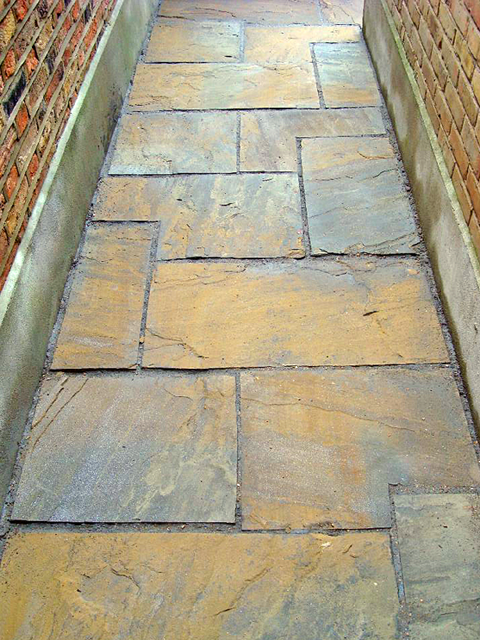 A pavement made from riven yorkstone paving flags